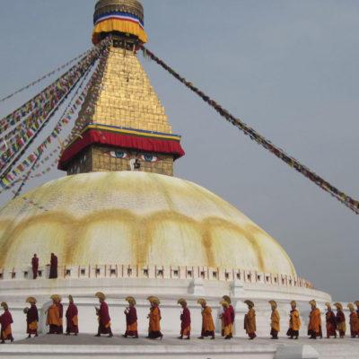 Monks circumnavigate the Boudha Stupa